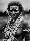 Woman dressed for a ceremony Ambasi village, Oro Province April 1921