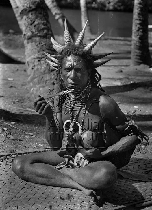 Man chewing betel nut Eroro village, Oro Bay, Oro Province April 1921