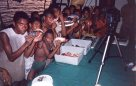 Kids with fishes Solomon Islands, 1998