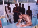 Updating the trip diary, Solomon Islands, 1998