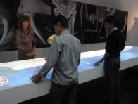 Student interacting with exhibition