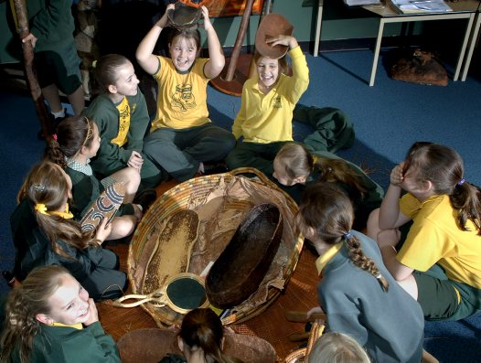 Students with Aboriginal women's artefacts