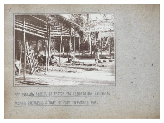 Men making thatch for buildings, Collingwood Bay, PNG