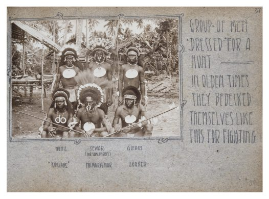 Group of men in hunting dress, Collingwood Bay, PNG
