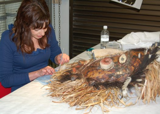 Kate conserving a mask from the Torres Straight Islands