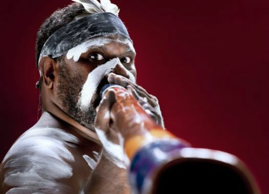 Aboriginal performer playing didgeridoo