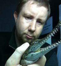 Chris Hosking with Snappy the Crocodile