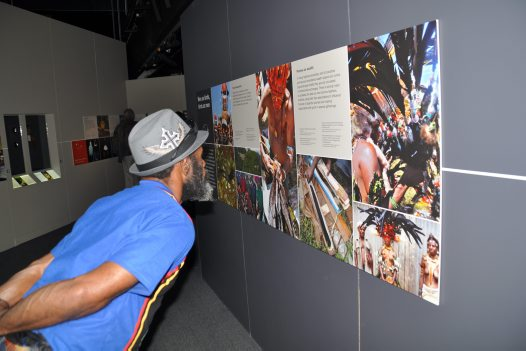 Chief Koken Kauage viewing images of his Waghi kinsmen on display