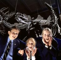 Students with dinosaur skeletons