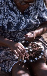 Cora Peters, elder on Mornington Island, making a Dah