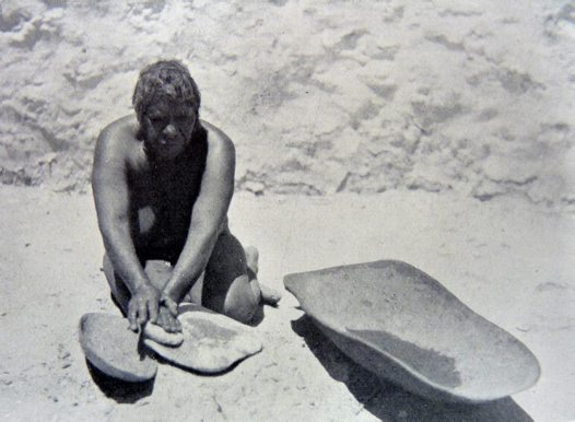 Woman Grinding Seeds