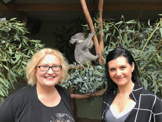 Kathy Belov and Rebecca Johnson with a koala at Featherdale
