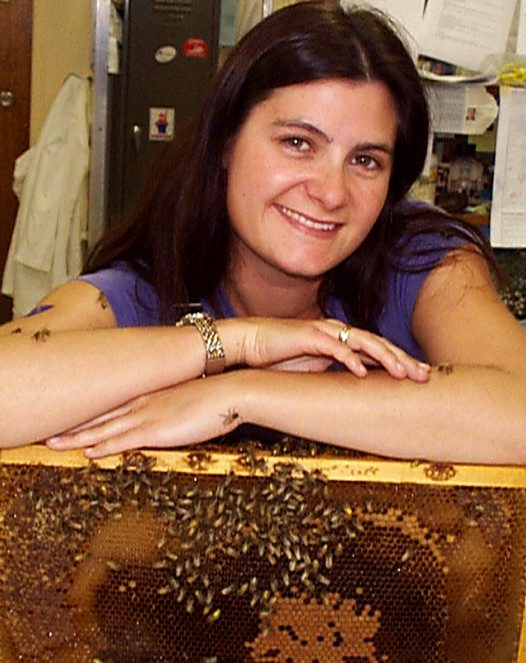 Rebecca Johnson with honey bee comb