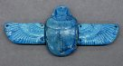Ancient Egyptian scarab amulet with wings
