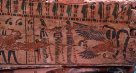 Ancient Egyptian coffin painted with winged serpent