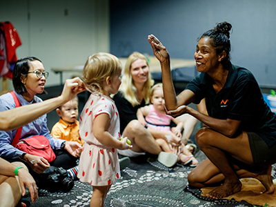 Aboriginal staff member, Charlie, performs an emu dance in Tiny Tots, photographed by James Horan