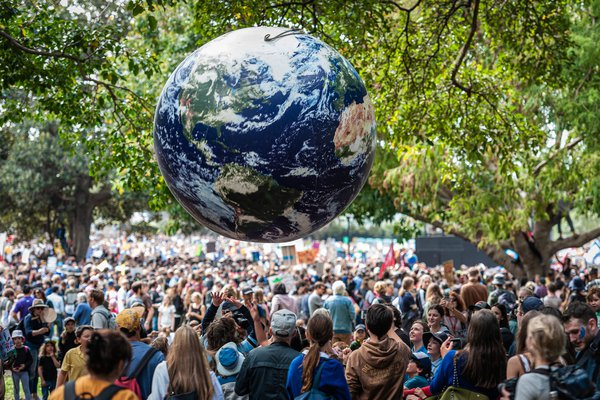 Tens of thousands of people, led by school kids, attend the Climate Strike in the Domain in Sydney on 20 September 2019. The rally was part of a global movement ahead of UN climate talks later that month.