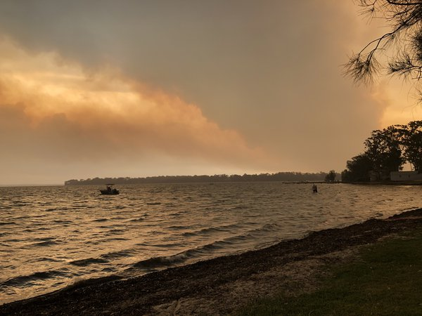 31 December 2019 - Erowal Bay covered with smoke plumes from nearby bushfires. A powerful southerly wind came through turning the usually-calm-water choppy. This photo was taken around 1pm but the smoke made the atmosphere so dark, it felt like night time.