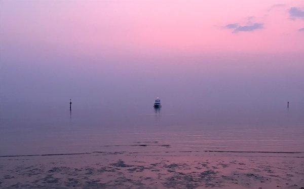 Williamstown beach shrouded in sunset haze from bushfire smoke. 13 January 2020, 9pm