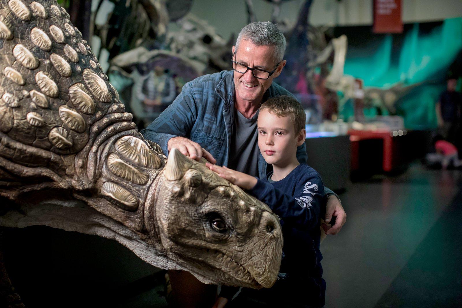 A family visiting Dinosaurs