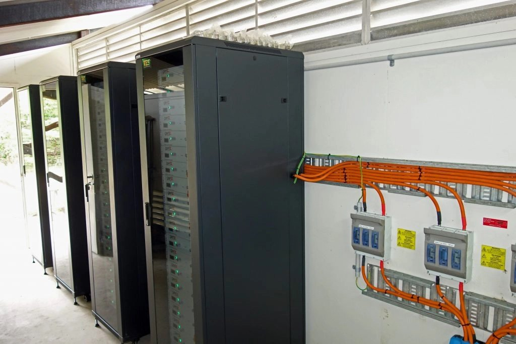 80 GenZ Lithium Ferro Phosphate batteries in four cabinets in the battery room