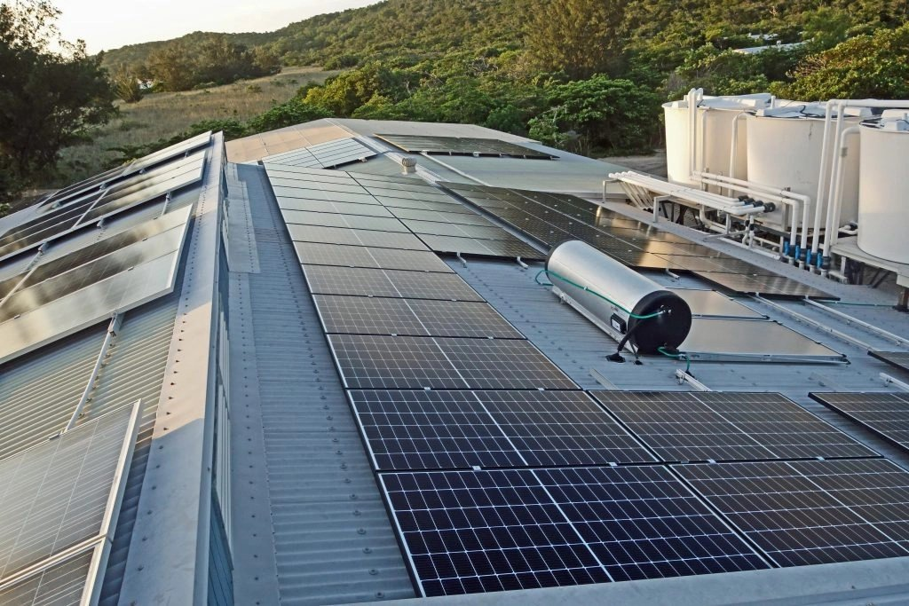 Some of the new solar panels on the roof of the Kalkhoven Wing and the aquarium