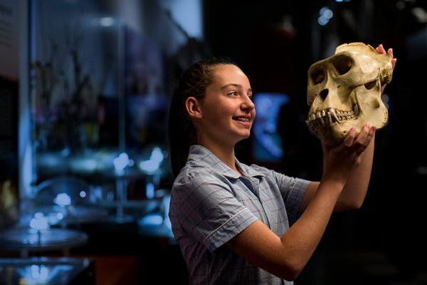 School girl looking at a skull