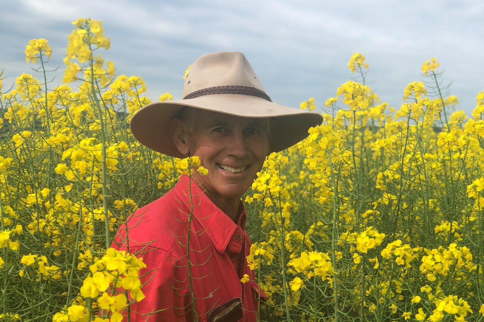Bill Daly in canola farm