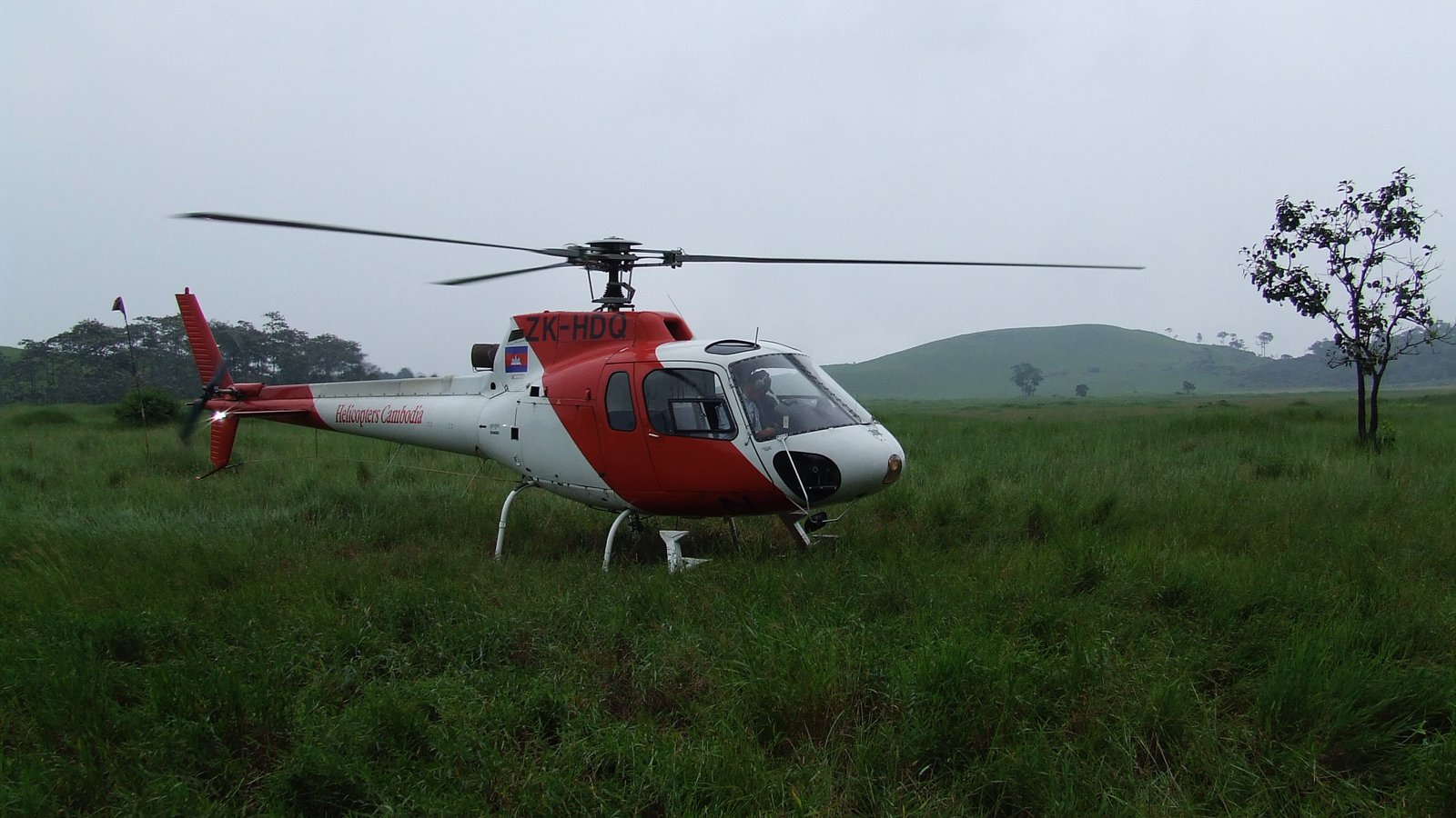Field team and departing helicopter, Virachey National Park, Cambodia.