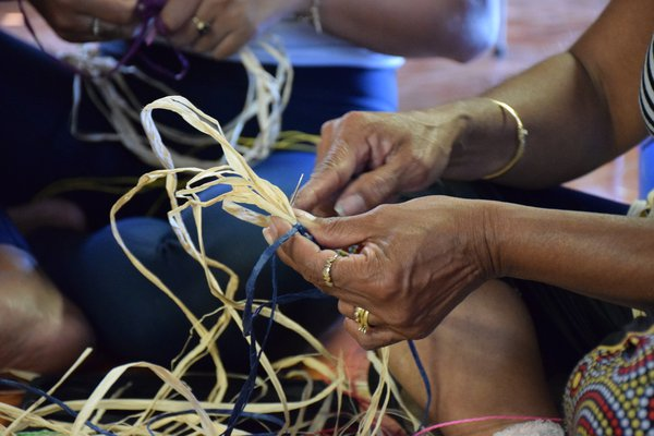 Weaving Kurrajong string and flowers