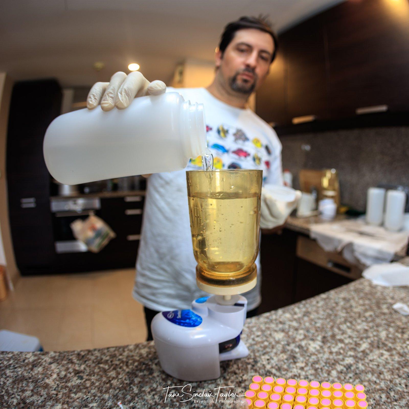 Dr Joseph DiBattista filters seawater in Oman.