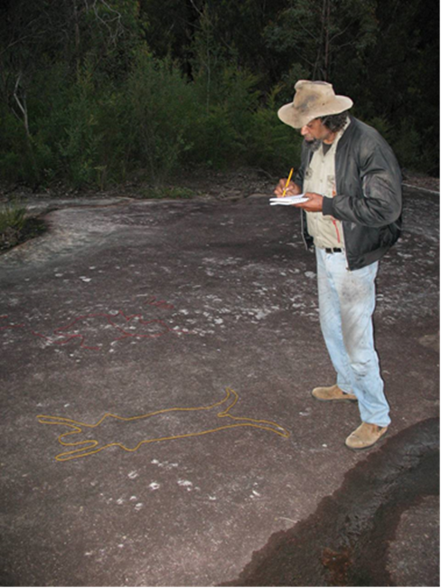 Roger Uluru Shannon sketching engravings highlighted with coloured wool, Gallery Rock