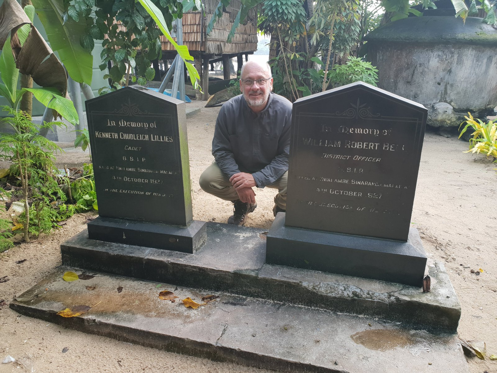 Tim Flannery next to the graves of two British men killed in 1927, Malaita, Solomon Islands