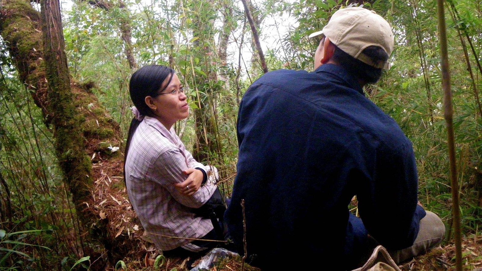 Duong Le and Vinh Dau in habitat of the Trieng Tree Frog (Gracixalus trieng), Vietnam.