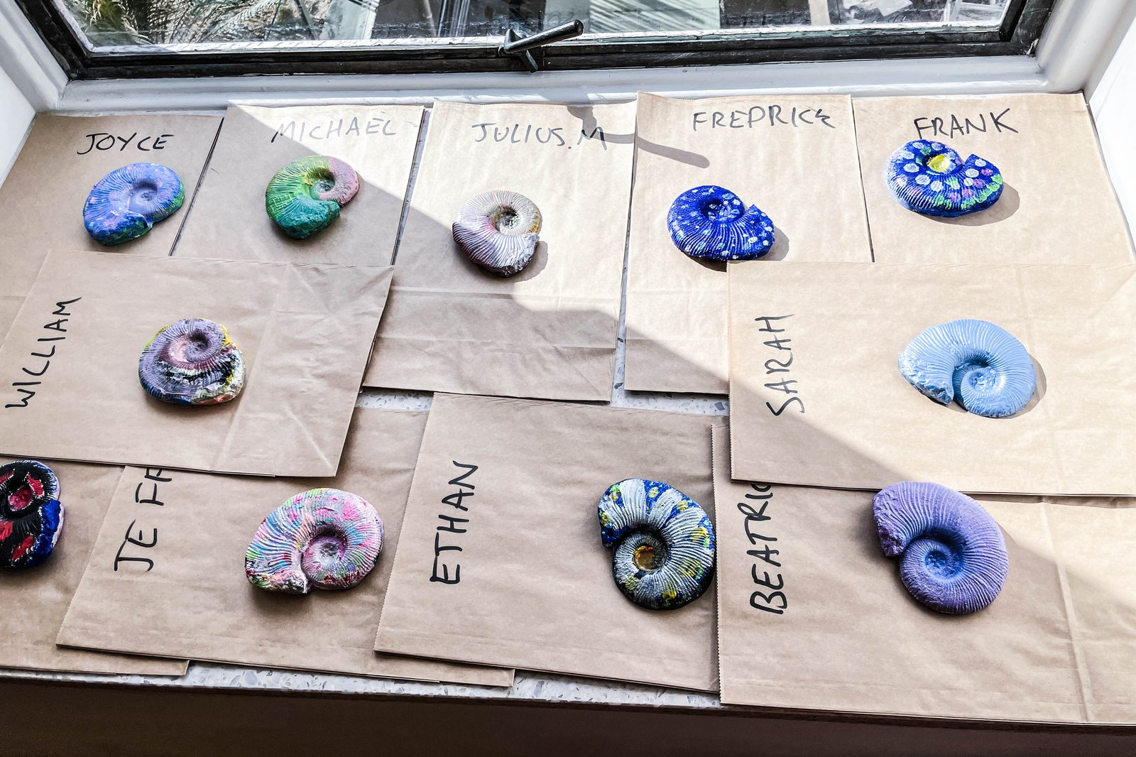 Painted ammonite fossil plaster casts