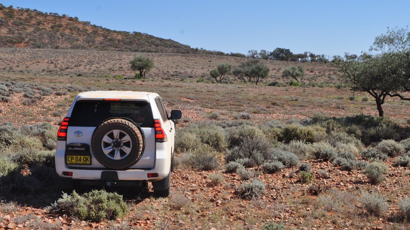 Photograph of fieldwork in the outback. Much of the Ordovician rocks preserved in the Amadeus Basin is found in similar regions to this, with dangerous creek crossings.