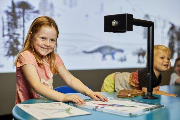 Kids in prehistoric playground