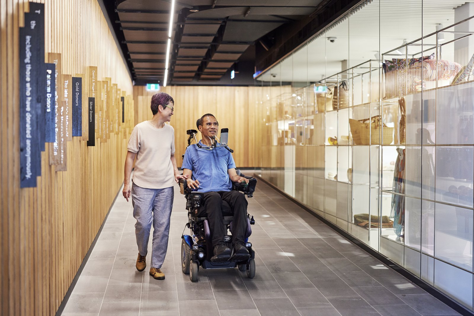 Man who uses a wheelchair and friend on Shop Ramp