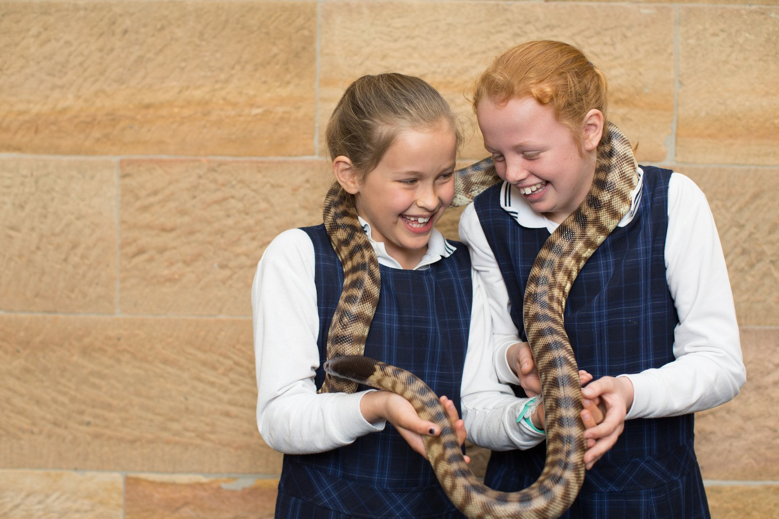 School girls with a snake