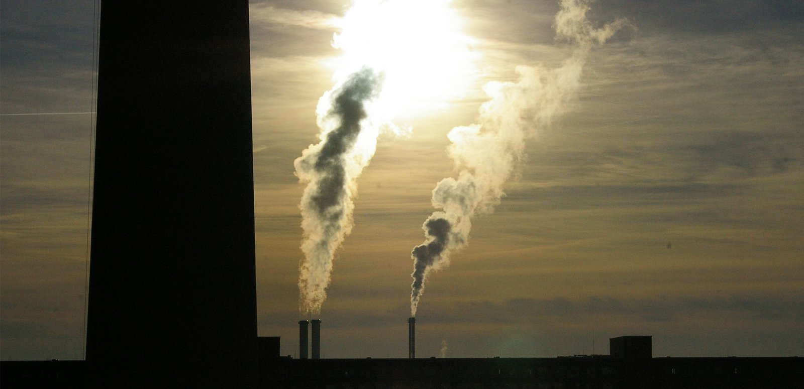 Smoke stacks at sunset