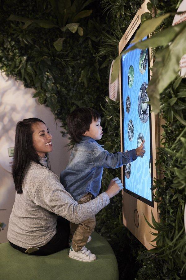 Australian Museum visitors playing FrogID
