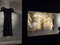 waagura (Crow) Dancer outfit and marayung wumara-warra (Sky Emu Travels) cloak in the Unsettled exhibition