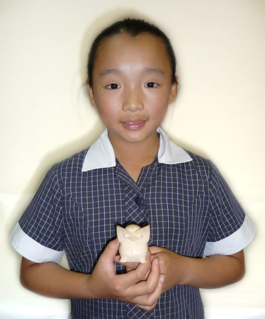 Amanda with wooden owl