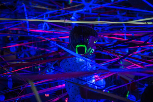 Child with fluorescent streamers