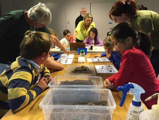 Kids unearth the secrets of soils with soil scientists.