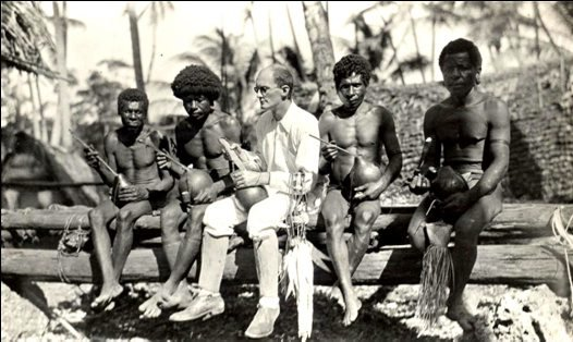 Malinowski socialising with Trobriand Islanders.