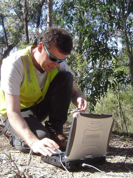 Dr Michael Ashcroft downloads climate data from an ibutton in the Wollemi National Park