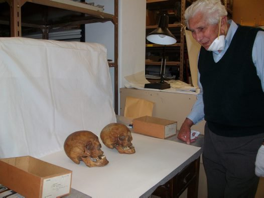 Keith Brown examining skulls of Lucretia Dunkley and Martin Beech