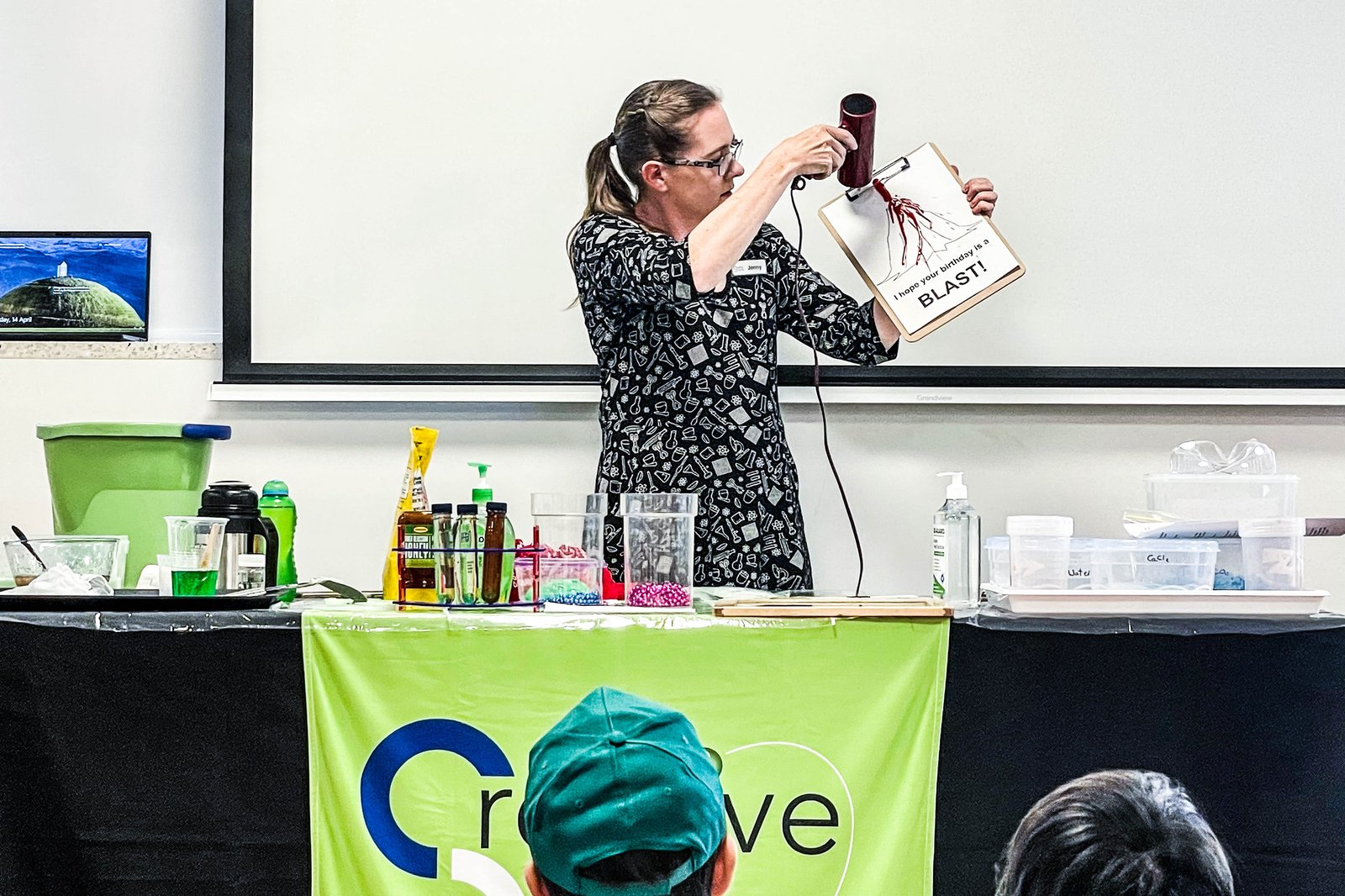 Jenny from Creative Science presenting a Slime Show