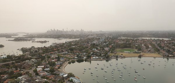 "Sydney from above during a recreational flight on 30 December 2019. After weeks of out-of-control bushfires across NSW that led to extremely low quality air conditions, this was supposed to be one of the ""better""days. Still, the city is barely discernible and everything seems to fade under a blanket of smog."